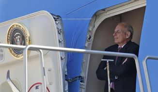 White House Chief of Staff John Kelly stands in the door of Air Force One and watches President Donald Trump, as he arrives in Reno, Nev., Wednesday, Aug. 23, 2017. (AP Photo/Alex Brandon)