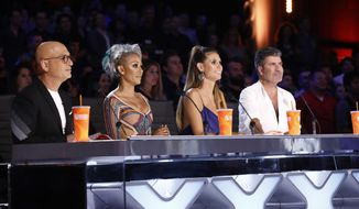 "In this Tuesday, Aug. 22, 2017 photo provided by NBC, judges Howie Mandel, Mel B, Heidi Klum and Simon Cowell participate in a live broadcast of ""America's Got Talent"" in Los Angeles. Mel B threw a cup of water on Cowell and walked off the stage after Cowell made a joke about her wedding night during the show. (Trae Patton/NBC via AP)"