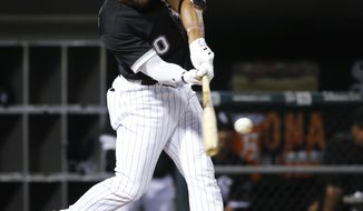 Chicago White Sox's Yoan Moncada hits an RBI double off Minnesota Twins relief pitcher Taylor Rogers during the eighth inning of a baseball game Wednesday, Aug. 23, 2017, in Chicago. (AP Photo/Charles Rex Arbogast)