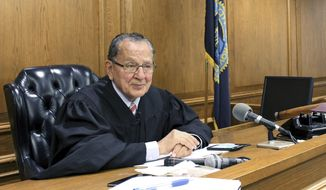 In this Aug. 10, 2017 photo, Providence Municipal Court Judge Frank Caprio sits on the bench in Providence, Rhode Island. The 80-year-old judge has been winning hearts and clicks on Facebook with a mix of compassion and humor from his courtroom in Providence, Rhode Island. Videos featuring Caprio have now reached hundreds of millions of views. (AP Photo/Michelle R. Smith)