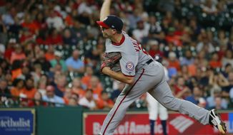 Washington Nationals' Brandon Kintzler delivers a pitch against the Houston Astros during the ninth inning of a baseball game Thursday, Aug. 24, 2017, in Houston. (AP Photo/Richard Carson)