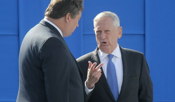 U.S. Defense Secretary James Mattis, right, speaks with Lithuania's Minister of Defense Raimundas Karoblis prior to a military parade to celebrate Independence Day in Kiev, Ukraine, Thursday, Aug. 24, 2017. (AP Photo/Efrem Lukatsky)