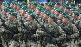 Ukrainian soldiers march along main Khreshchatyk Street during a military parade to celebrate Independence Day in Kiev, Ukraine, Thursday, Aug. 24, 2017. (AP Photo/Efrem Lukatsky)