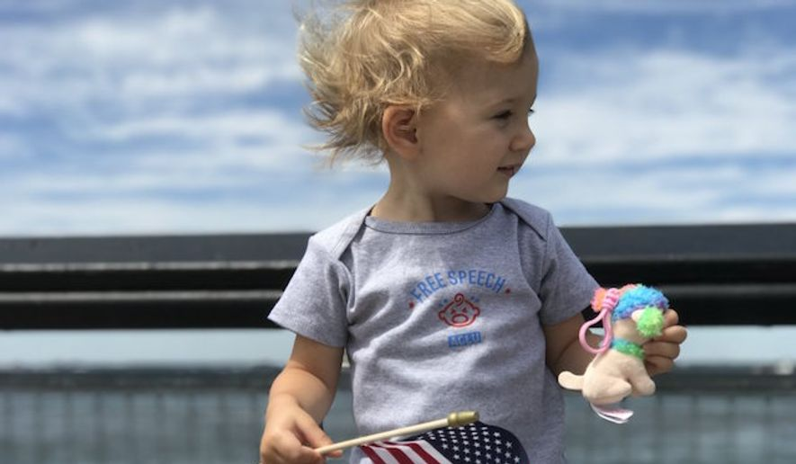The American Civil Liberties Union backpedaled on tweeting a photo Wednesday of a white baby holding a U.S. flag after users called it racist. (ACLU)