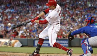 Cincinnati Reds' Joey Votto hits an RBI single off Chicago Cubs starting pitcher Jake Arrieta during the fourth inning of a baseball game, Thursday, Aug. 24, 2017, in Cincinnati. (AP Photo/John Minchillo)