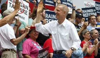 FILE - In this Aug. 16, 2017 file photo, Illinois Gov. Bruce Rauner greets supporters before he takes the stage at a Republican Day rally at the Illinois State Fair in Springfield, Ill. Four members of Gov. Rauner's communications staff have resigned weeks after being hired in the wake of the Republican's inconsistent response to a political cartoon that critics call racist. Rauner issued a statement Thursday, Aug. 24, 2017, saying Diana Rickert, Laurel Patrick, Meghan Keenan and Brittany Carl submitted resignations.(Rich Saal/The State Journal-Register via AP, File)