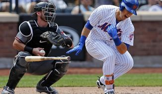 New York Mets Michael Conforto reacts after injuring himself swinging at a pitch during the fifth inning of a baseball game against the Arizona Diamondbacks on Thursday, Aug. 24, 2017, in New York. (AP Photo/Adam Hunger)