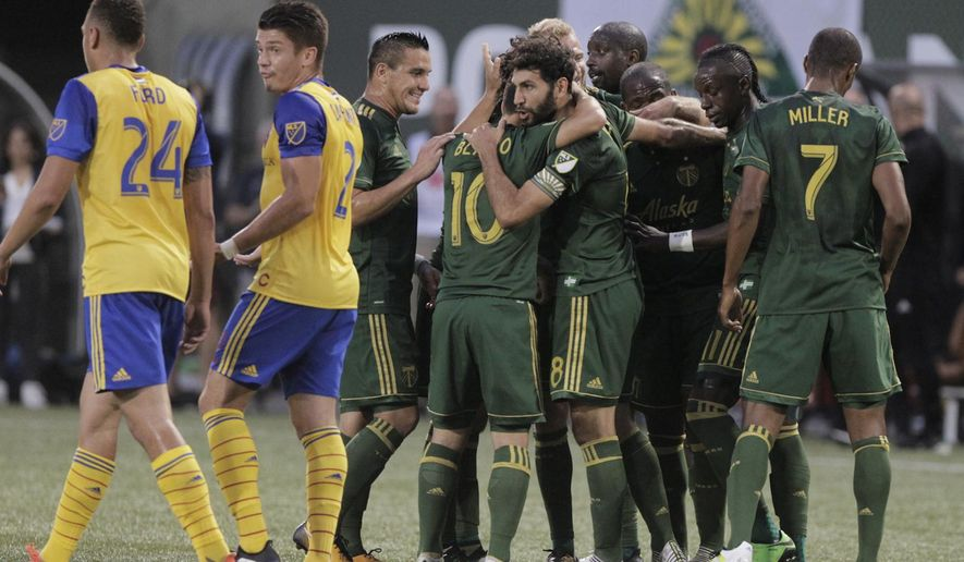Portland Timbers' Diego Valeri (8) celebrates a goal against the Colorado Rapids during an MLS soccer match Wednesday, Aug. 23, 2017, in Portland, Ore. (Sean Meagher/The Oregonian via AP)