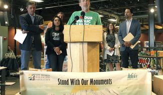 REI government affairs director Marc Berejka relays the outdoor retailer's support for public lands and the protection of national monuments that were under review by the Trump administration during a news conference at the REI store in Albuquerque, N.M., on Thursday, Aug. 24, 2017. Dozens of people packed the store to rally in support of New Mexico's two monuments and others on the list. (AP Photo/Susan Montoya Bryan)