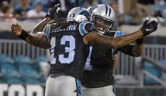 Carolina Panthers quarterback Cam Newton (1) celebrates after throwing a pass for a touchdown to wide receiver Kelvin Benjamin (13) during the first half of an NFL preseason football game against the Jacksonville Jaguars, Thursday, Aug. 24, 2017, in Jacksonville, Fla. (AP Photo/Stephen B. Morton)