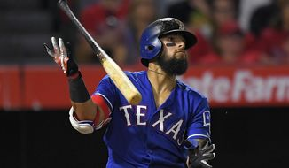 Texas Rangers' Rougned Odor flips his bat after hitting an RBI sacrifice fly during the 10th inning of a baseball game against the Los Angeles Angels, Wednesday, Aug. 23, 2017, in Anaheim, Calif. (AP Photo/Mark J. Terrill)