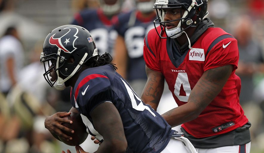 Houston Texans quarterback Deshaun Watson (4) hands off to running back Dare Ogunbowale (44) during a joint practice with the New Orleans Saints at the Saints NFL football training facility in Metairie, La., Thursday, Aug. 24, 2017. (AP Photo/Gerald Herbert)