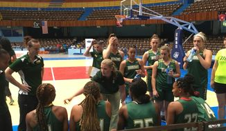 This photo taken Aug. 15, 2017, shows Siena women's coach Ali Jaques talking with her team before a game against the Cuban national team at Coliseo de la Ciudad Deportiva in Havana, Cuba. Siena played three games against the Cuban national team, plus hosted two clinics in an effort to grow the game on the island nation. (AP Photo/Tim Reynolds)