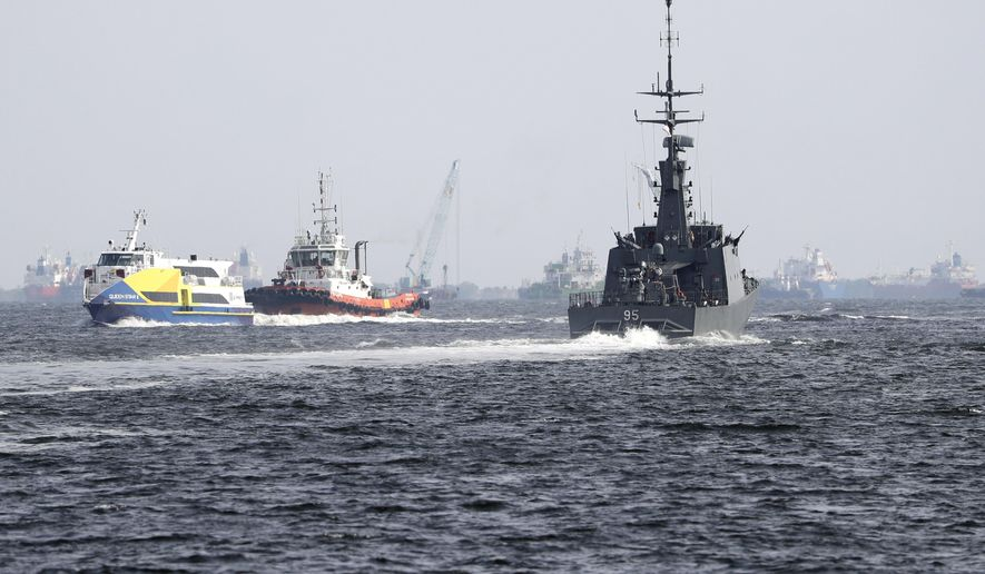The Republic of Singapore Navy's RSS Brave, right, sails off from the Tuas naval base on a search and rescue mission for the USS John S. McCain's missing sailors on Thursday, Aug. 24, 2017, in Singapore. Aircraft and ships from the navies of Singapore, Malaysia, Indonesia and Australia are searching seas east of Singapore where the collision between the USS John S. McCain and an oil tanker happened early Monday. (AP Photo/Wong Maye-E)
