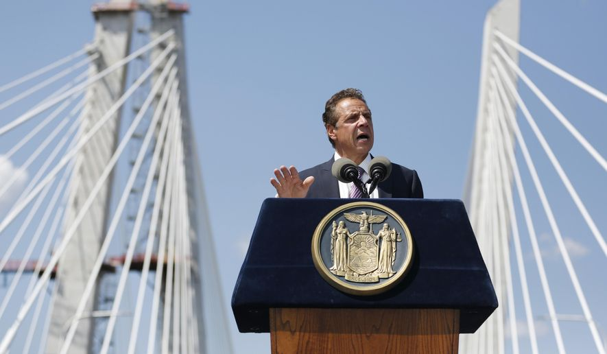 New York Governor Andrew Cuomo speaks during a ribbon cutting ceremony for the Tappan Zee Bridge replacement, called the Gov. Mario M. Cuomo Bridge, on a span of the new bridge near Tarrytown, N.Y., Thursday, Aug. 24, 2017. The event was held a day before vehicles start rolling across the massive new Hudson River span. Cuomo and a host of other dignitaries attended Thursday's ceremony for the 3-mile long bridge, which is being named after Cuomo's late father. (AP Photo/Seth Wenig)