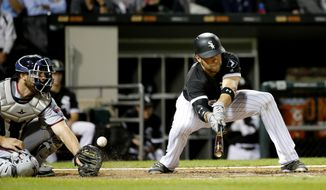 Chicago White Sox's Kevan Smith, right, strikes out on a foul bunt as Minnesota Twins catcher Jason Castro defends during the seventh inning of a baseball game Wednesday, Aug. 23, 2017, in Chicago. (AP Photo/Charles Rex Arbogast)