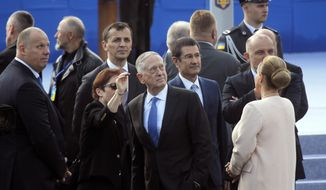 U.S. Defense Secretary Jim Mattis, center, attends a military parade to celebrate independence day in Kiev, Ukraine, Thursday, Aug. 24, 2017. The Ukraine officially declared itself independent from the Soviet Union on April 24, 1991. (AP Photo/Efrem Lukatsky)