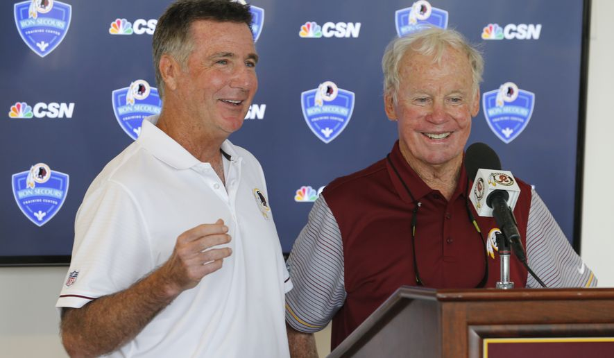 Washington Redskin general manager, Bruce Allen, left, announced that former Redskins GM Bobby Beathard, right, will be inducted in the Redskins Ring of Fame during a press conference at the Washington Redskins NFL football teams training camp in Richmond, Va., Saturday, July 30, 2016. (AP Photo/Steve Helber)