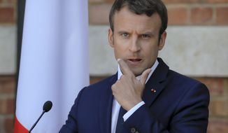 French President Emmanuel Macron gestures during a press conference with his Bulgarian counterpart Rumen Radev at the Euxinograd residence outside Varna, Bulgaria, Friday, Aug. 25, 2017. Macron arrived Friday at a French-style palace on the Black Sea coast for talks with Bulgarian leaders on the final leg of his three-day tour to central and eastern Europe.(AP Photo/Vadim Ghirda)
