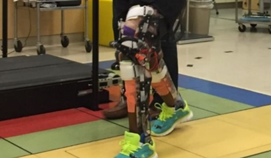 Children with cerebral palsy practice walk with a robotic exoskeleton at the National Institutes of Health's Clinical Center Department of Rehabilitation Medicine in Bethesda, Maryland. (National Institutes of Health)