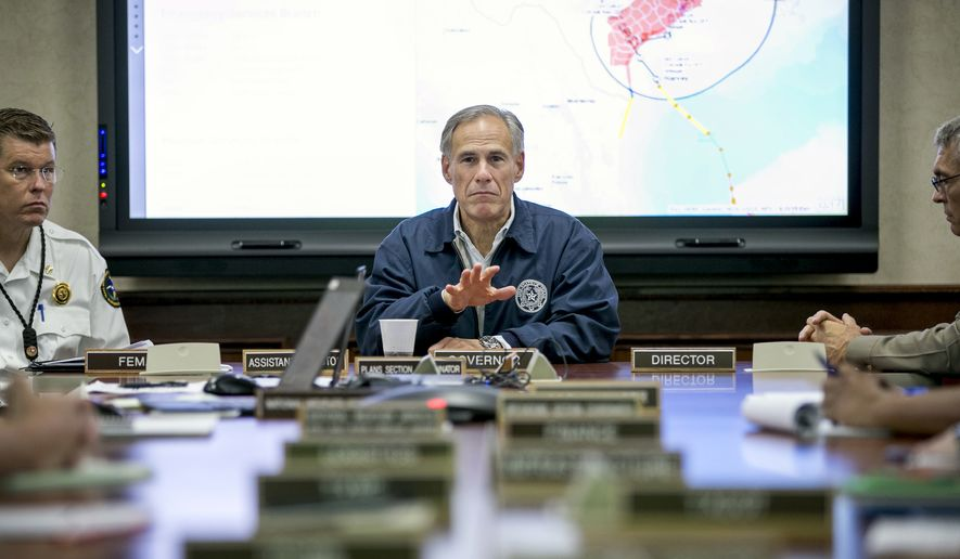 Gov. Greg Abbott attends a meeting with local, state and federal officials at the State Operations Center in Austin, Texas, on Friday Aug. 25, 2017, in preparation for Hurricane Harvey. (Jay Janner/Austin American-Statesman via AP)