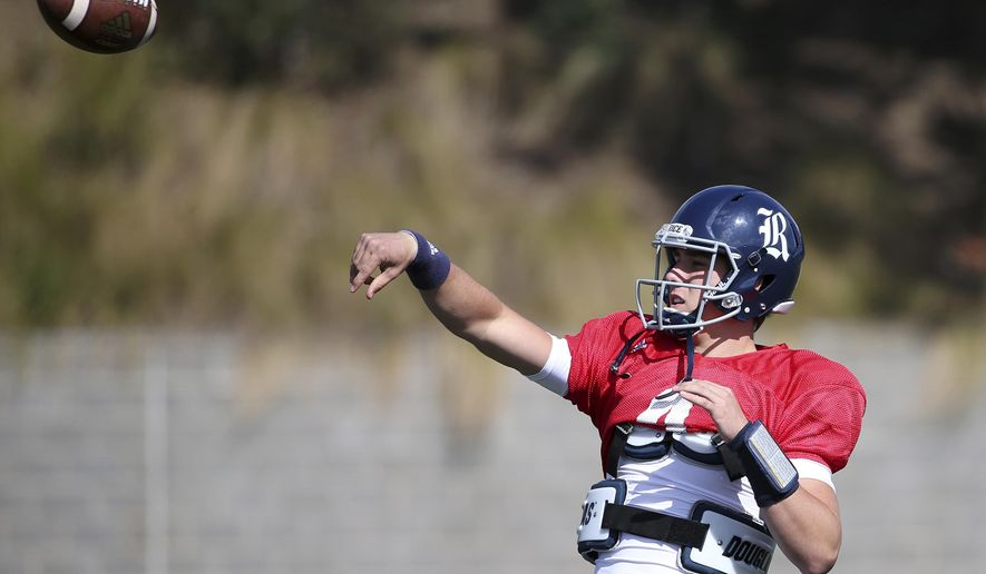 U.S. college Rice's football player Sam Glaesmann throws a ball as his team trains ahead of the season opening game against Stanford in Sydney, Thursday Aug. 24, 2017. The game will be played on Sunday. (AP Photo/Rick Rycroft)