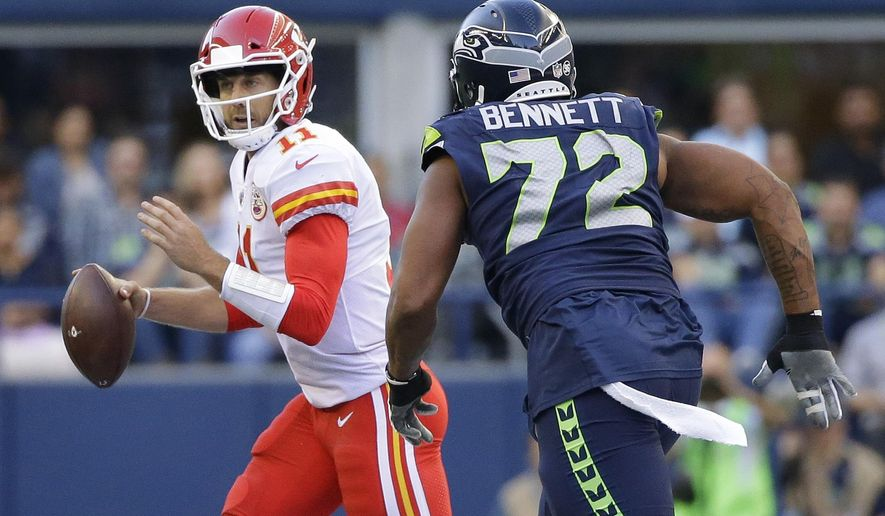 Seattle Seahawks defensive end Michael Bennett (72) pressures Kansas City Chiefs quarterback Alex Smith during the first half of an NFL football preseason game, Friday, Aug. 25, 2017, in Seattle. (AP Photo/Elaine Thompson)