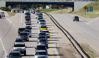 This Monday, Aug. 21, 2017 photo shows heavy traffic moving slowly along Interstate 80 in Cheyenne, Wyo. Wyoming was one of the states in the path of the total eclipse, and thousands of people poured into the state for the view, causing massive traffic jams that are normally seen in major metropolitan areas. The Wyoming Department of Transportation reported imprecise traffic counts that showed an increase of more than 550,000 vehicles compared to a five-year average for Aug. 21. (Blaine McCartney/The Wyoming Tribune Eagle via AP)
