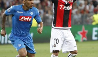 Nice's Wesley Sneijder, right, gestures past Napoli's Allan during a Champions League playoff round, second leg soccer match between Nice and Napoli in Nice, France, Tuesday, Aug. 22, 2017. (AP Photo/Claude Paris)