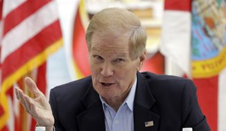 Sen. Bill Nelson, D-Fla., talks to a group of Haitian community leaders, Friday, Aug. 25, 2017, in the Little Haiti area in Miami.  Nelson called on the administration to extend Temporary Protected Status for the nearly 60,000 Haitians living in the U.S. until at least July, 2019. Such extensions are typically renewed for 18-month intervals, but the latest announcement in May said it would expire in six months. Haitians granted the protection can live and work in the U.S. without fear of deportation. (AP Photo/Alan Diaz)