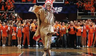 """FILE - In this Feb. 21, 2007 file photo, University of Illinois mascot Chief Illiniwek performs for the last time during an Illinois basketball game in Champaign, Ill. Illinois says the school is ending its tradition of playing """"war chant"""" music during sporting events. Athletic department spokesman Kent Brown says the Illini made the decision in an effort to be more inclusive and because students haven't responded to it as much at football games. The music stems from the school's former mascot, Chief Illiniwek, a tradition that ended in 2007. (AP Photo/Seth Perlman, File)"""