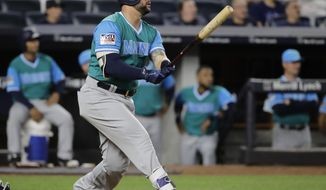 Seattle Mariners' Yonder Alonso follows through on a home run during the 11th inning of a baseball game against the New York Yankees on Friday, Aug. 25, 2017, in New York. (AP Photo/Frank Franklin II)