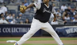 New York Yankees' CC Sabathia winds up during the first inning of a baseball game against the Seattle Mariners on Friday, Aug. 25, 2017, in New York. (AP Photo/Frank Franklin II)
