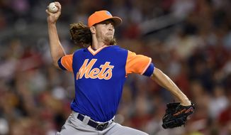 New York Mets starting pitcher Jacob deGrom delivers a pitch during the third inning of a baseball game against the Washington Nationals, Friday, Aug. 25, 2017, in Washington. (AP Photo/Nick Wass)