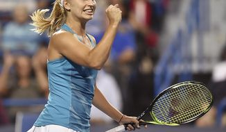 Australia's Daria Gavrilova celebrates after defeating Agnieszka Radwanska, of Poland, in the semifinals of the Connecticut Open tennis tournament Friday, Aug. 25, 2017, in New Haven, Conn. Gavrilova won, 6-4, 6-4. (Catherine Avalone/New Haven Register via AP)