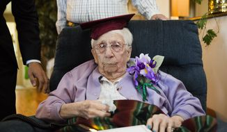 "Iris Weatherwax, 97, was belatedly awarded her high school diploma in a private ceremony on Wednesday, Aug. 23, 2017, at her residence in Grand Blanc, Mich. Weatherwax was barred from graduating from the Davison Community School District in 1938 because she was pregnant at the time, despite the fact that she was also married. Before Wednesday's ceremony, Weatherwax asked, ""Is it alright if I cry?"" (Terray Sylvester/The Flint Journal-MLive.com via AP)"