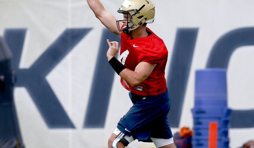 FILE - In this Aug. 11, 2017, file photo, Pittsburgh quarterback Max Browne (4) passes during an NCAA college football practice in Pittsburgh. Head coach Pat Narduzzi named Browne as the team's starting quarterback. (AP Photo/Keith Srakocic, File)