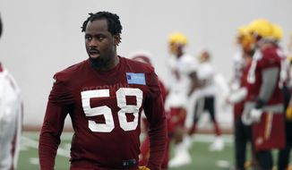 In this photo taken May 24, 2017, Washington Redskins linebacker Junior Galette (58) works during practice at the team's NFL football training facility at Redskins Park in Ashburn, Va. Galette worked to get back from tearing his left Achilles tendon and then his right, but now another problem is keeping him off the field. The linebacker has been bothered by a hamstring injury during training camp and missed the Washington Redskins' first two preseason games. (AP Photo/Alex Brandon) **FILE**