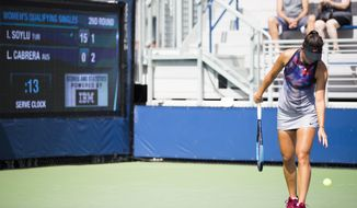 Ipek Soyluas, of Turkey, prepares to serve as the serve clock ticks down Thursday, Aug. 24, 2017, during U.S. Open tennis qualifying in New York. The serve clock is one of the changes being tested at the tournament. If Stacey Allaster, the U.S. Tennis Association's chief executive for professional tennis, has her way, changes such the serve clock and in-match coaching could make their way into the main draw of the tourney next year. (AP Photo/Michael Noble Jr.)