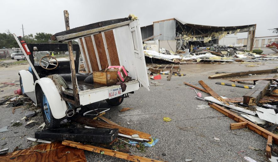 Debris is scattered from Hurricane Harvey Saturday, Aug. 26, 2017, in Katy, Texas.  Harvey rolled over the Texas Gulf Coast on Saturday, smashing homes and businesses and lashing the shore with wind and rain so intense that drivers were forced off the road because they could not see in front of them.  (AP Photo/David J. Phillip)