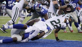 New York Giants defensive end Jason Pierre-Paul (90) tackles New York Jets' Matt Forte (22) for a safety during the first half of a preseason NFL football game Saturday, Aug. 26, 2017, in East Rutherford, N.J. (AP Photo/Julio Cortez)