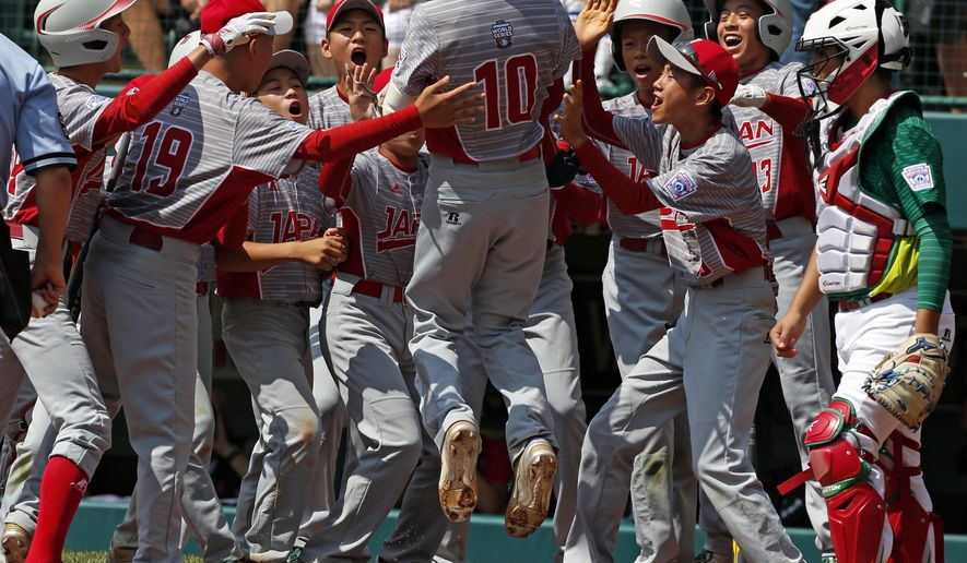 Japan's Keitaro Miyahara (10) is greeted by teammates after hitting a solo home run off Mexico pitcher Jorge Garcia in the first inning of the International Championship baseball game at the Little League World Series tournament, Saturday, Aug. 26, 2017, in South Williamsport, Pa. (AP Photo/Gene J. Puskar)