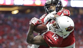 Arizona Cardinals wide receiver John Brown (12) makes a touchdown catch ahead of Atlanta Falcons cornerback C.J. Goodwin (29) during the first half of an NFL football game, Saturday, Aug. 26, 2017, in Atlanta. (AP Photo/David Goldman)