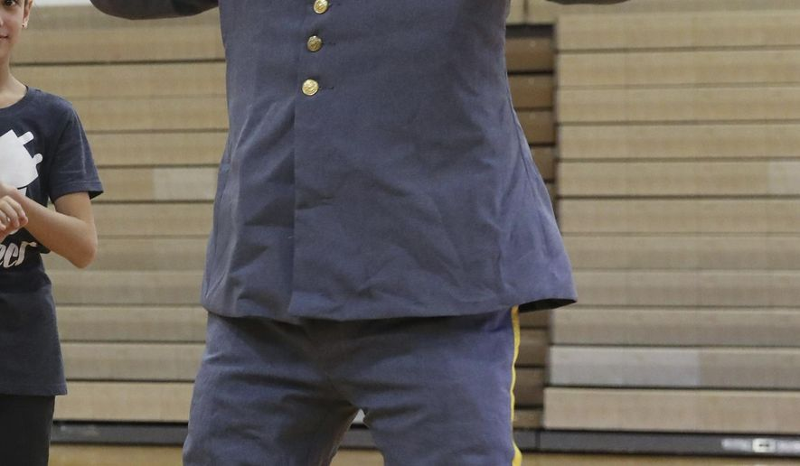 This Jan. 27, 2017, file photo, depicts Weld Central Middle School's mascot. The national debate over Confederate statues has spread to a northern Colorado high school whose mascot is called the Rebel and wears a costume resembling a Civil War uniform in Keenesburg, Colo. The Greeley Tribune reported Saturday, Aug. 26, 2017, Weld Central School District considers the mascot to be a symbol of Weld Central High School pride, not racism. (Greeeley Tribune via AP, File)