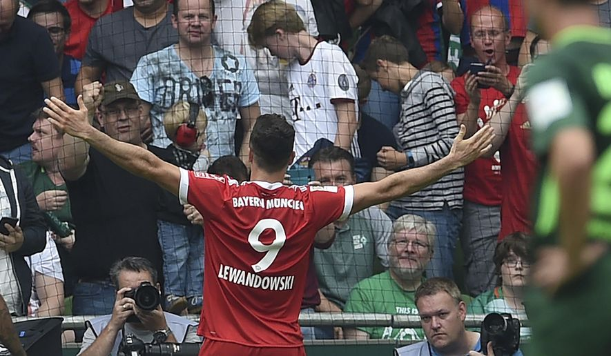 Munich's Robert Lewandowski celebrates after scoring his second goal during the German first division Bundesliga soccer match between Werder Bremen and Bayern Munich in Bremen, Germany, Saturday, Aug. 26, 2017. (Carmen Jaspersen/dpa via AP) via AP)