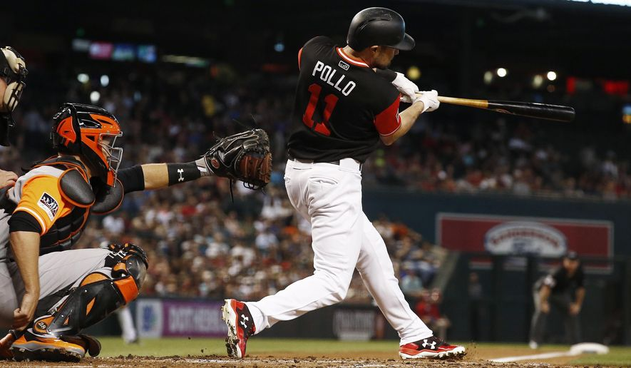 Arizona Diamondbacks' A.J. Pollock (11) connects for a home run as San Francisco Giants' Buster Posey, left, reaches out with his glove during the first inning of a baseball game Saturday, Aug. 26, 2017, in Phoenix. (AP Photo/Ross D. Franklin)
