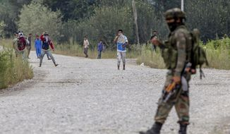 Kashmiri protesters clash with Indian army soldiers near the site of a gunbattle in Pulwama, about 35 Kilometers south of Srinagar, Indian controlled Kashmir, Saturday, Aug. 26, 2017. At least two gunmen entered a police camp in southern Pulwama town firing guns and grenades at the sentry, said Director-General of police S.P. Vaid. (AP Photo/Dar Yasin)