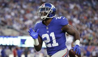 New York Giants' Landon Collins (21) returns an interception for a touchdown during the first half of a preseason NFL football game against the New York Jets on Saturday, Aug. 26, 2017, in East Rutherford, N.J. (AP Photo/Julio Cortez) **FILE**