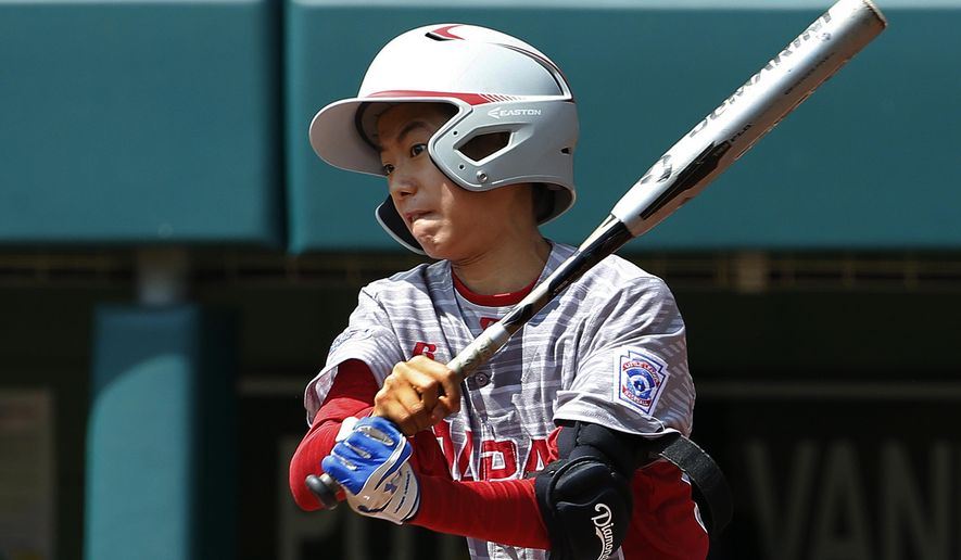 Japan's Yuya Nakajima drives in two runs with a bases loaded single off Mexico pitcher Jorge Garcia in the first inning of the International Championship baseball game at the Little League World Series tournament, Saturday, Aug. 26, 2017, in South Williamsport, Pa. (AP Photo/Gene J. Puskar)