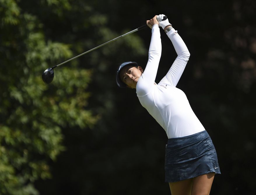 Michelle Wie of the United States drives from the fourth tee during the third round of the Canadian Pacific Women's Open golf tournament in Ottawa, Ontario, Saturday, Aug. 26, 2017. (Sean Kilpatrick/The Canadian Press via AP) **File**